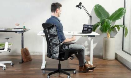 Person sitting in black Kinn chair