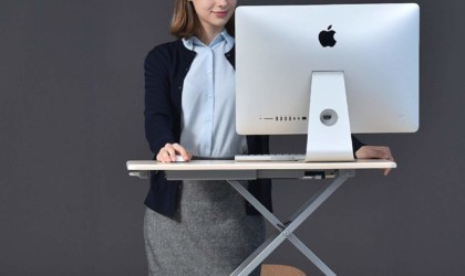 Person using UPERGO as standing desk