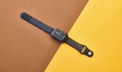 A cool tech gadgets from Kickstarter fitness watch lying on a yellow and brown background.