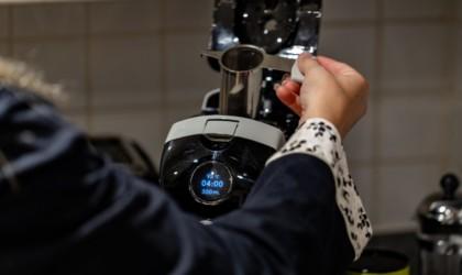 A hand placing a tea holder into a cool tech gadgets from Kickstarter tea brewer.