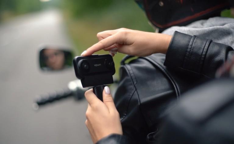Woman's hands holding a cool tech gadgets from Kickstarter camera.