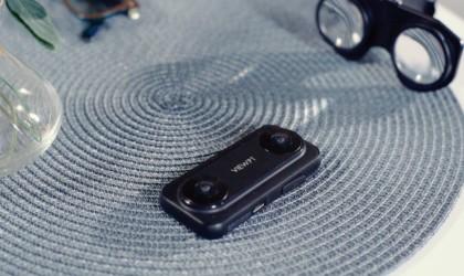A black cool tech gadgets from Kickstarter camera on a gray mat.