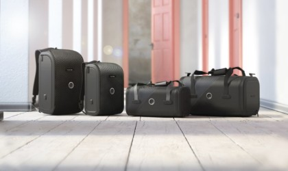 A row of five black cool tech gadgets from Kickstarter suitcases.