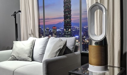 A new tech gadgets air purifier next to a window showing a cityscape.