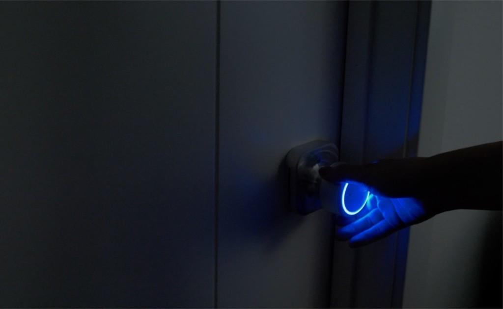 A new tech gadgets doorknob light in the dark, with a blue light.