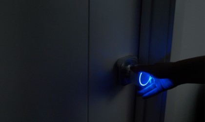 A new tech gadgets doorknob light in the dark, with a blue light.