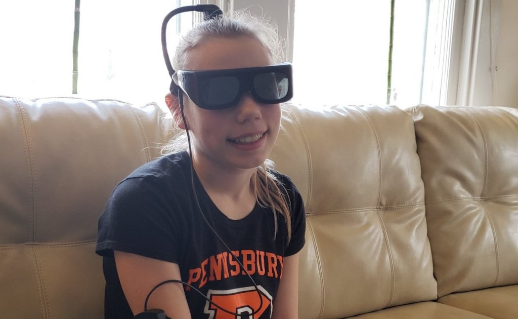 A little girl wearing a pair of new tech gadgets glasses.