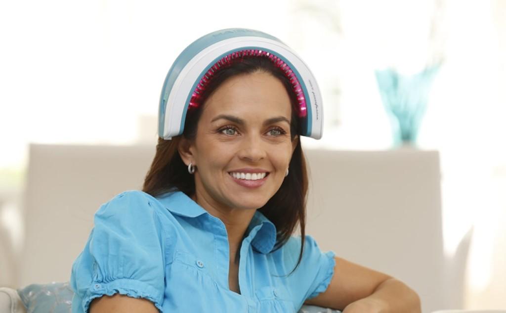 A woman wearing a new tech gadgets laser hair growth band.
