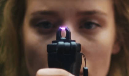 A person holding a new tech gadgets survival device with a purple electric flame