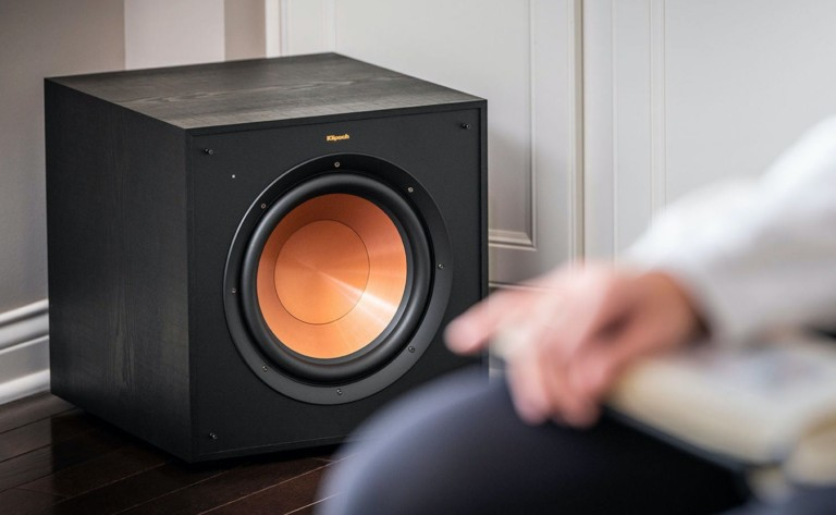 A black wireless speaker subwoofer with a copper middle.