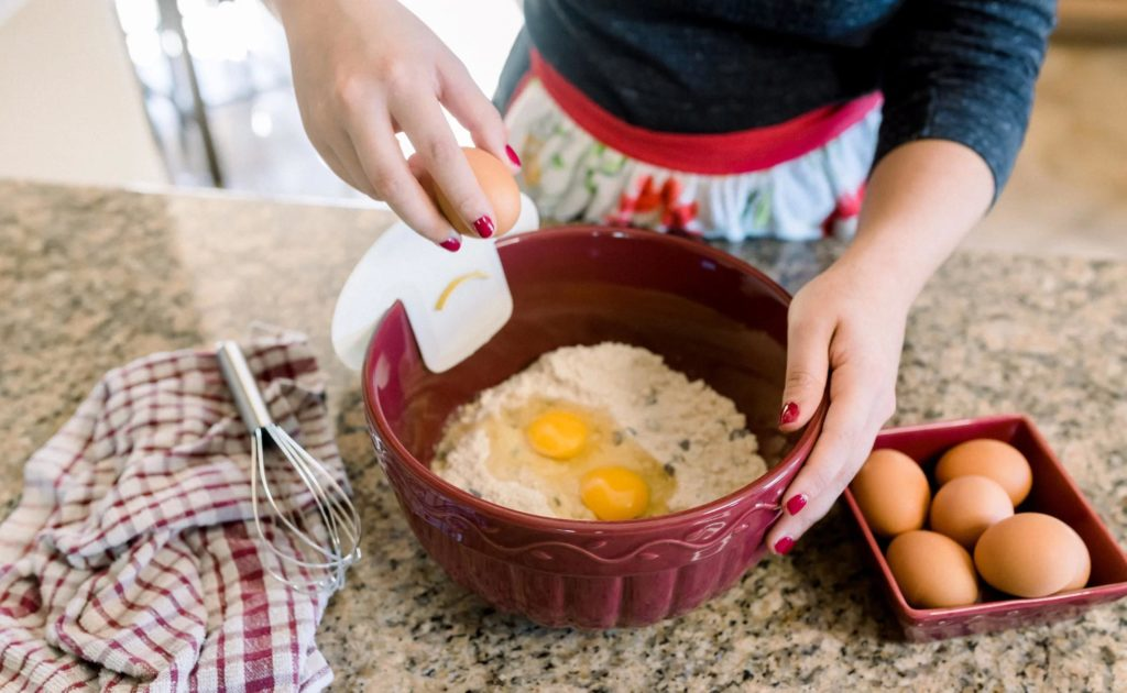 cracking on egg with an egg-cracking tool