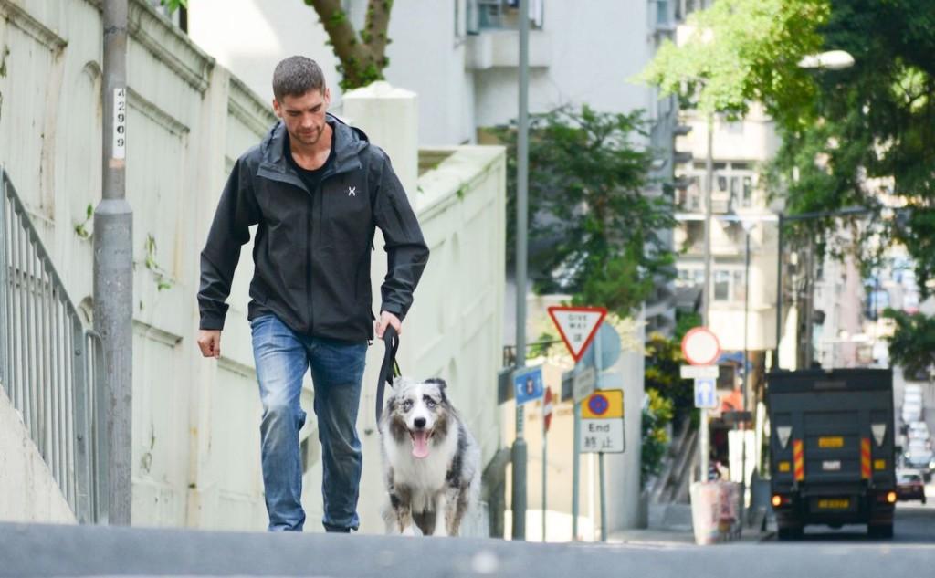 high-performance jacket walking the dog