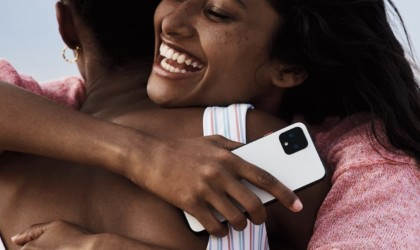 Person hugging, holding Pixel 4