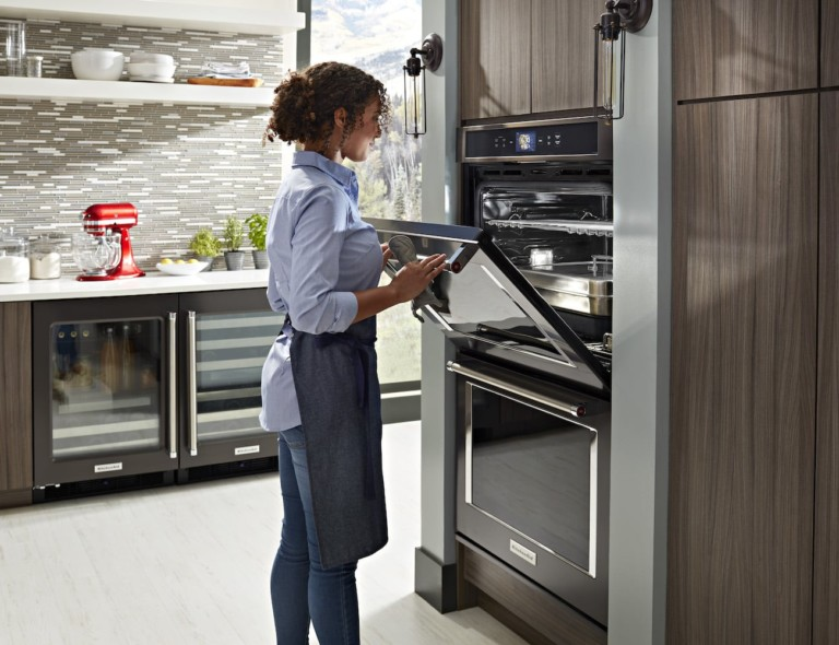 Person opening smart oven