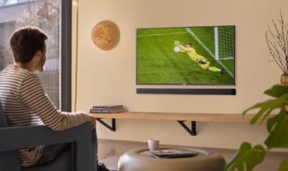 JBL soundbar mounted under a TV