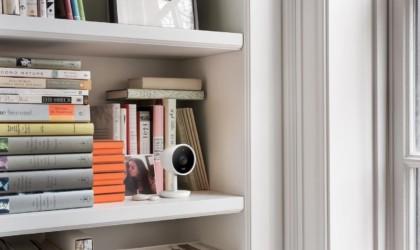 Nest Cam IQ on a bookshelf