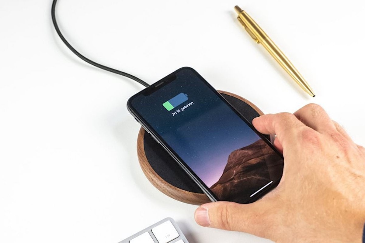 Woodcessories EcoPad Wireless Charging Station is made of entirely walnut wood