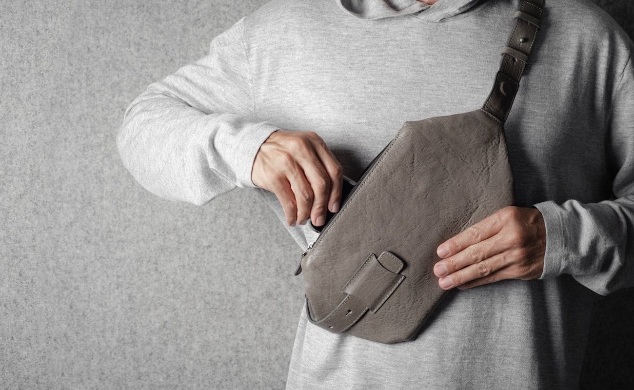 Person wearing the Cross-Body Bag in Off-Grey