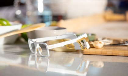 Set of white smart glasses resting on a counter