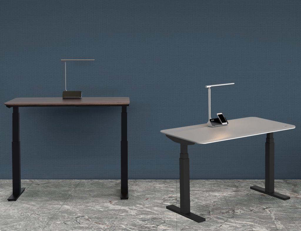 Two minimalist desks with built-in lamps on top