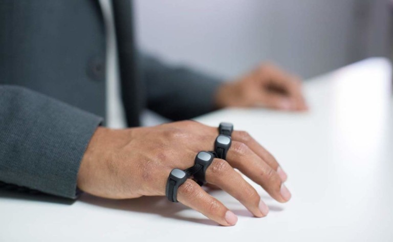 Person wearing sensors on fingers and typing