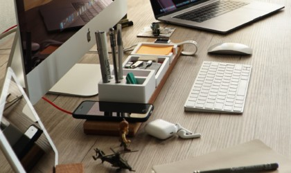 a side view of a useful office gadgets desk organizer with wireless charger.