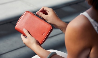 Person holding closed passport wallet