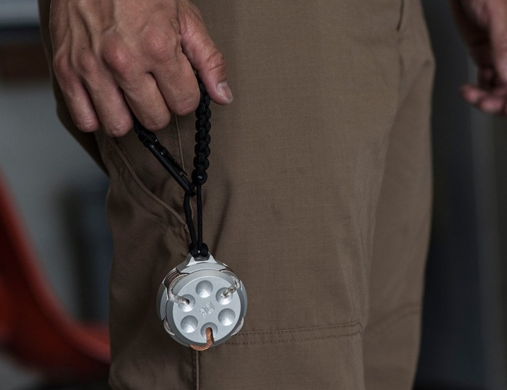 Person holding lanyard for coin organizer