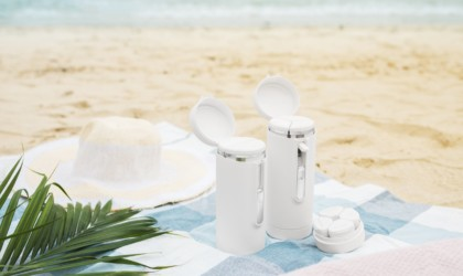 Toiletry organizers on the beach