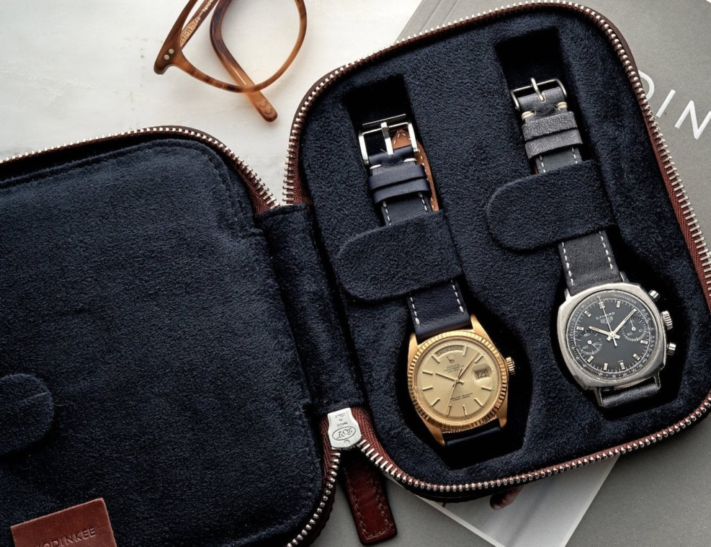 Open watch travel case with two watches inside