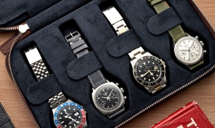 Close up of four watches in watch travel case