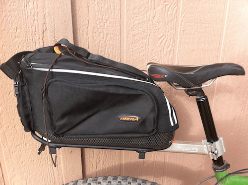 A close-up side view of a bike bag on the back of a bicycle.