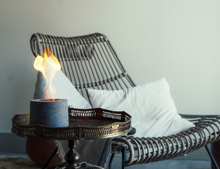 Modern flame lamp in front of wooden chair