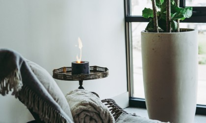 Chair, table, and large planter with flame in lamp