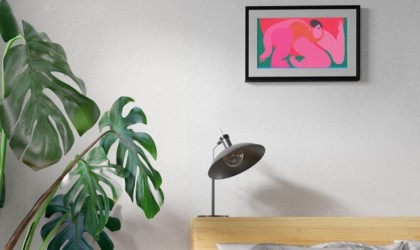 Horizontal digital picture frame above a lamp