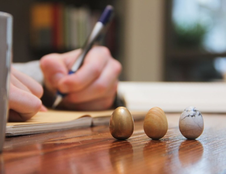 Set of thinking eggs sitting on a desk