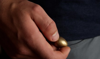 Close up of person holding a thinking egg