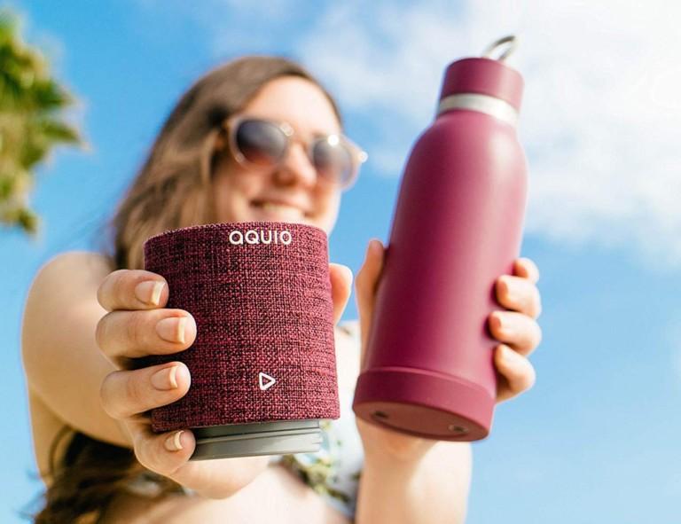 Woman holding water bottle speaker combo