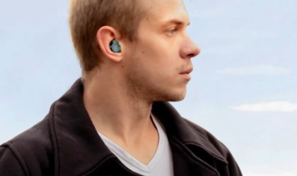 Man looking out of the frame wearing wireless earbuds