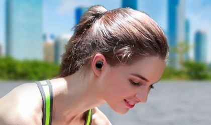 Woman in workout gear with wireless earbuds
