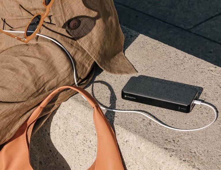 Compact power bank resting near travel gear