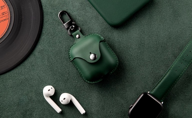 Apple AirPods and green leather case
