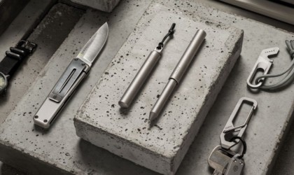 Two minimalist pens next to each other on concrete surface