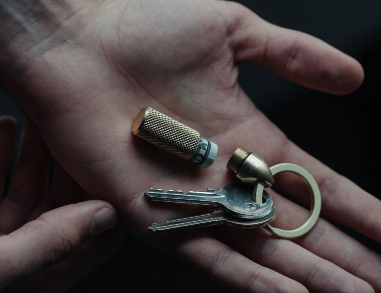 Person holding compact storage key chain