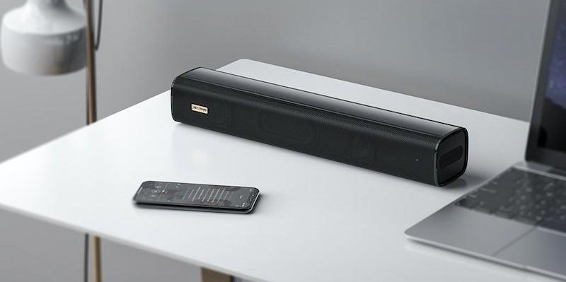 Compact soundbar on a white desk