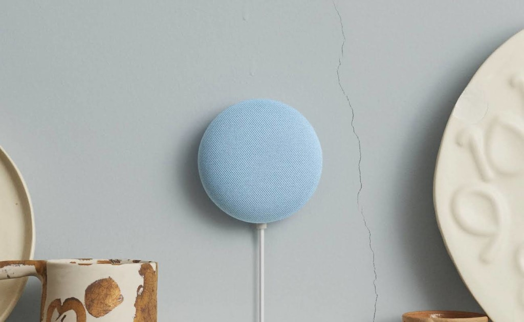 Blue Nest Mini attached to blue wall with crack in the paint