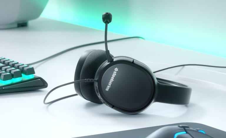 Gaming headset resting backward on white surface