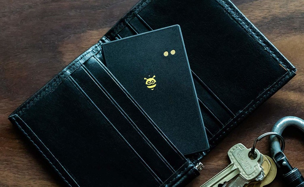 A black wallet finder card is sticking out of a wallet.