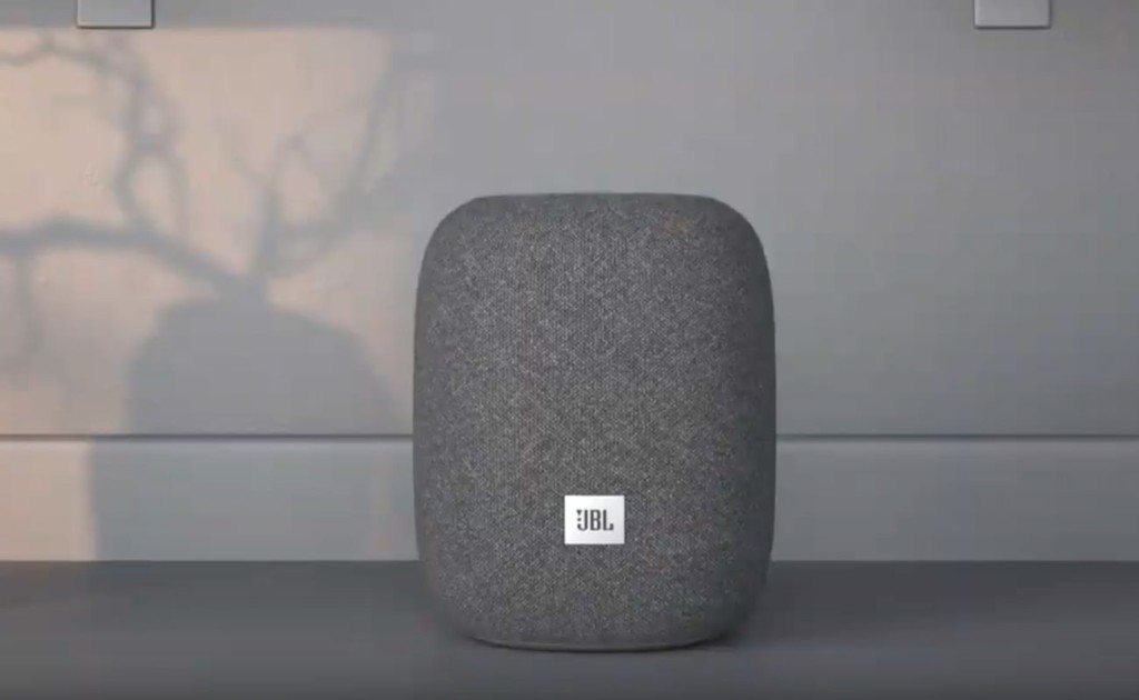 A small round gray speaker against a white background.