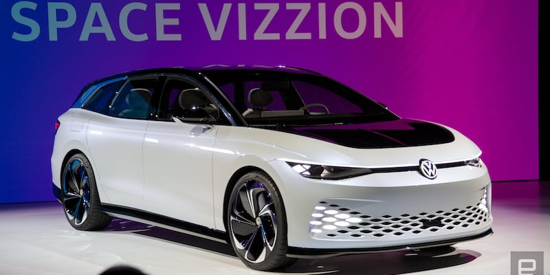 A white future car of Volkswagen is parked on a car show stage.